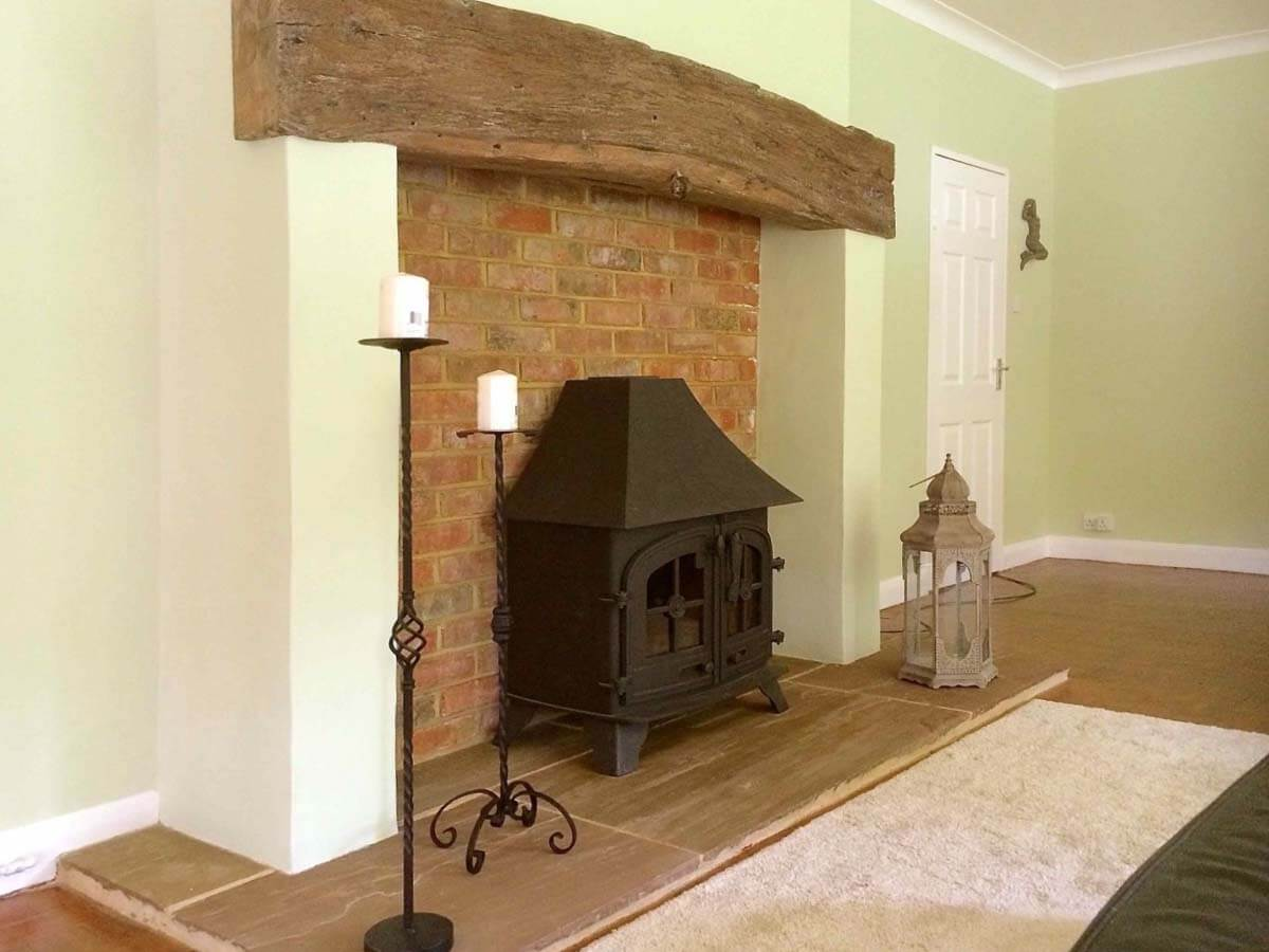 300 year old beam fireplace corrected