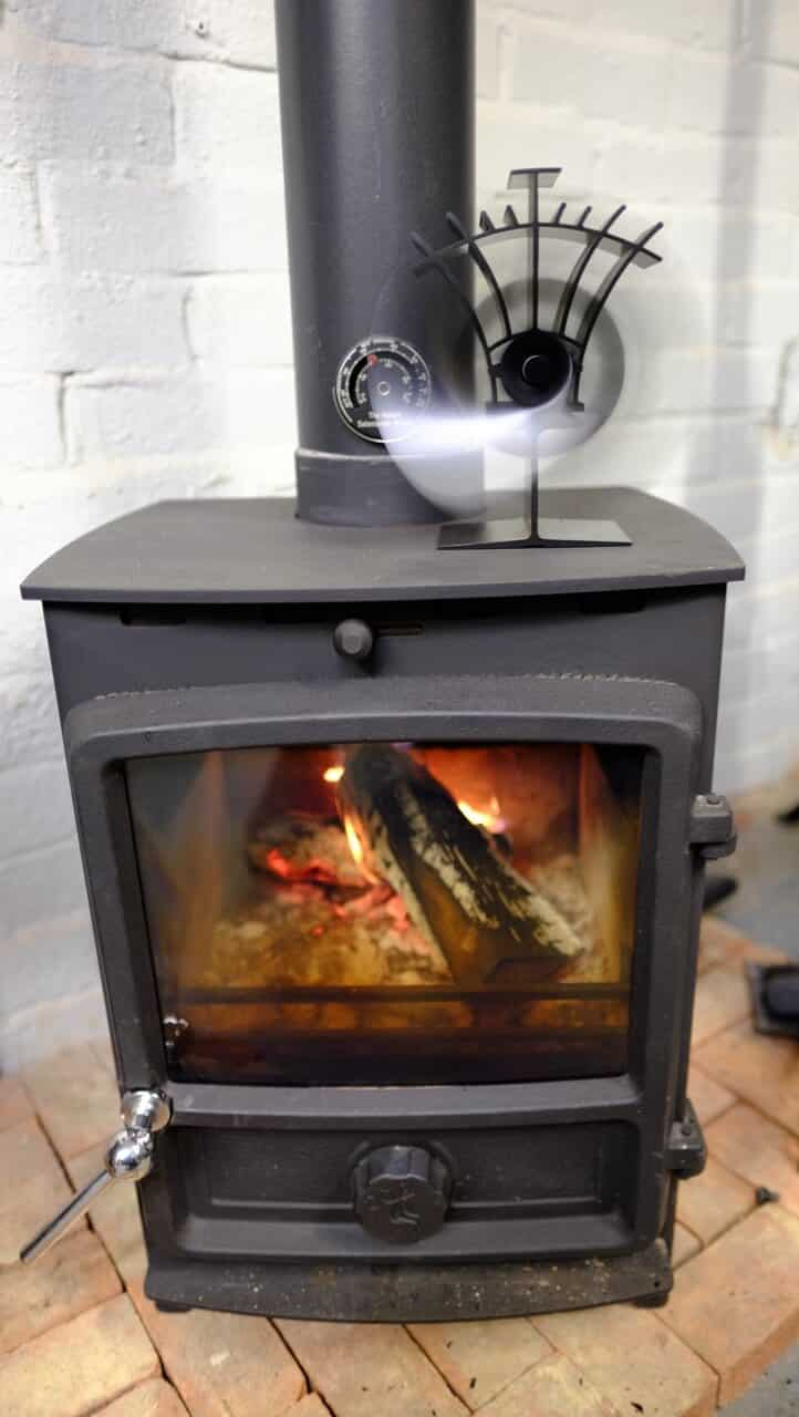 FDC 5 Wood Burning stove installed with stove top fan in our own showroom..Cosy!