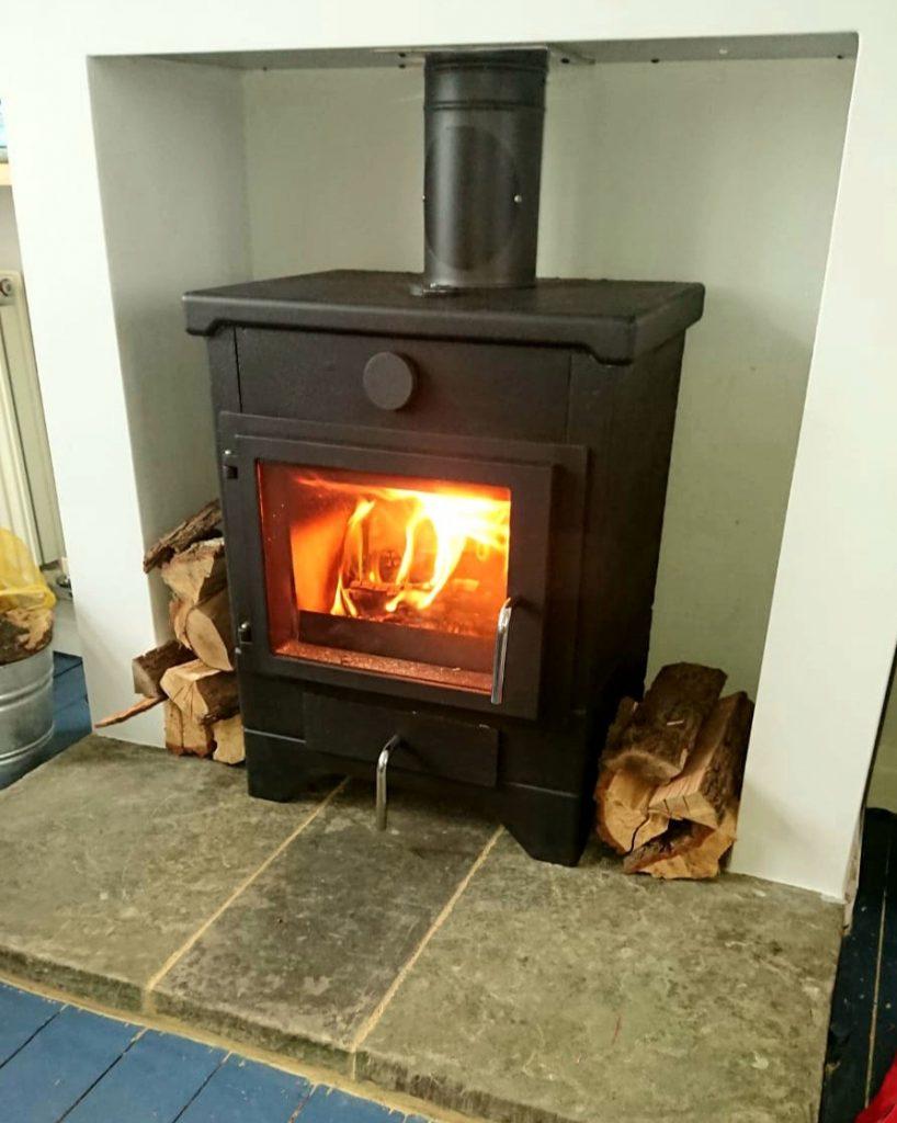 Ecco E580 masonry stove in rebuilt fireplace